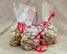 Pistachios packed in mini bags Stock Photos