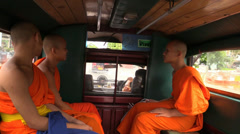 Monks ride inside songthaew car. Chiang Mai, Thailand. Stock Footage