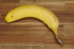 banana on a tabletop of acacia wood - stock photo
