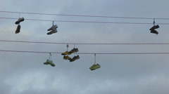 Shoes on wire Stock Footage
