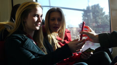 Teen Girl On A Train Showing Her Friends Her Phone Stock Footage