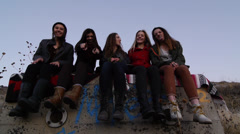 Portrait Of Five Pretty Teen Girls  Sitting On A Wall And Being Silly Stock Footage