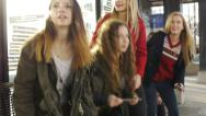 Stock Video Footage of Six Teen Girls At A Station Get Up For A Train