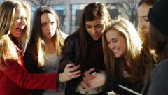 Six Teen Girls Looking Over Each Others Phones Stock Footage