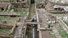 Men at work in archeology ancient Roman excavation - stock footage