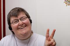 Mentally disabled woman with earphone Stock Photos