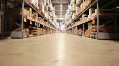 Camera moving between palettes with ordered goods and materials at warehouse Stock Footage
