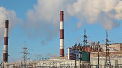 City power generating station with chimneys at winter season, Russia Stock Footage