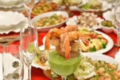 shrimp in a glass with pea sauce - stock photo
