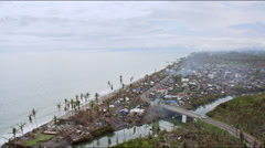 Aerial of destroyed village on the coast with bridges and roads Stock Footage