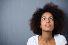 serious wistful young woman with an afro - stock photo