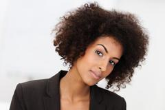 sceptical african american businesswoman - stock photo