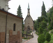 SALZBURG, AUSTRIA - St. Peters Cemetery with Chapel and catacombs + pan - stock footage