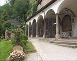 Stock Video Footage of SALZBURG - Arched gallery at St. Peters Cemetery + pan Chapel and tombstones
