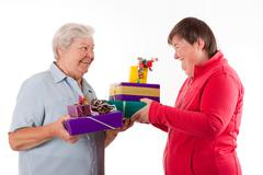 senior and mental disabled woman holding gifts - stock photo