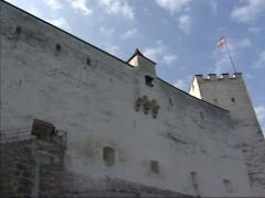 Low angle view at fortress Hohensalzburg Castle + pan tower with battlements Stock Footage