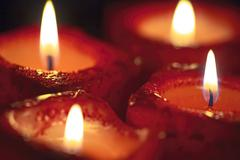 Stock Photo of red candles out of focus