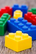 Stock Photo of color plastic  blocks on wooden background