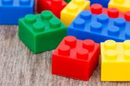 Stock Photo of plastic  blocks on the wooden background