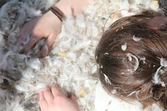 Downy feathers, hands & hairs Stock Photos