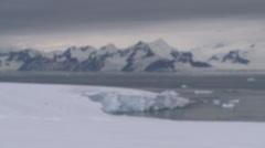 Glacier in to sea, looming clouds, , Antarctica - stock footage