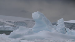 Bergs trapped in sea ice, Antarctica Stock Footage