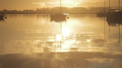 Sunset over Harbour with boats in Background Stock Footage