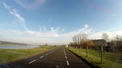 Vehicle shot Dutch river landscape - the south bank River Rhine + moraine hill Stock Footage