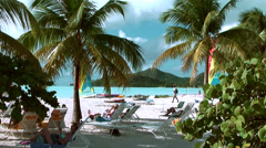 Antigua Jolly Beach 094, sands white like snow, people chilling under palms Stock Footage