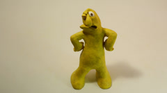 Hand draw attention of a yellow grumbling clay character, part 2 Stock Footage