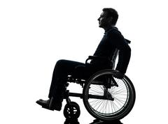 side view serious handicapped man in wheelchair silhouette - stock photo