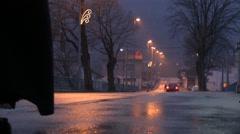 Elderly woman walking at night on wet roads Stock Footage