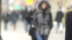 City pavement with pedestrians in winter day - stock footage