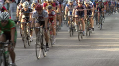 Bicycle Race - Pelotan Travels down City Street Stock Footage