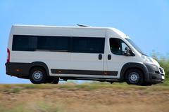minibus goes on country highway - stock photo