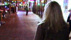 Woman Walks Down Urban City Street at Night Stock Footage