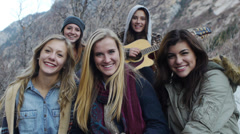 Portrait of A Group Of Teen Girls Gathered For An Outdoor Winter Sing-Along Stock Footage