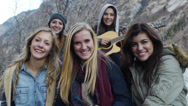 Stock Video Footage of Portrait of A Group Of Teen Girls Gathered For An Outdoor Winter Sing-Along