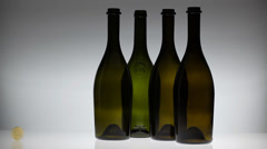 Four bottles and gold coin Stock Footage