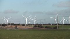 Train passing wind farm Stock Footage
