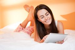 Brunette beauty browsing.gorgeous young brunette woman using tablet computer in  Stock Photos
