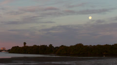 Full moon at sunrise over Tampa Bay Stock Footage
