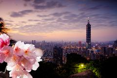 Skyline of Xinyi District in downtown Taipei, Taiwan. - stock illustration