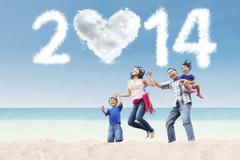Happy family celebrate new year 2014 at beach Stock Illustration