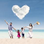 happy family run at beach under love cloud - stock illustration