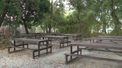 Empty table-bench on peaceful park Stock Footage