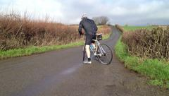 Road bike racer setting off on ride Stock Footage