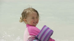 Young girls play on beach Stock Footage