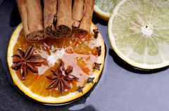 orange and lemon slices with star anise - stock photo