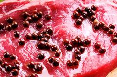 pink pepper and sirloin steak - stock photo